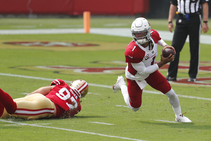 Arizona Cardinals quarterback Kyler Murray (1) scrambles from San Francisco 49ers defensive end Nick Bosa during the first half of an NFL football game in Santa Clara, Calif., Sunday, Sept. 13, 2020. (AP Photo/Josie Lepe)