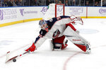 Columbus Blue Jackets goaltender Elvis Merzlikins (90), of Latvia, reaches for a loose puck during the second period of an NHL hockey game against the St. Louis Blues on Friday, Nov. 1, 2019, in St. Louis. (AP Photo/Jeff Roberson)