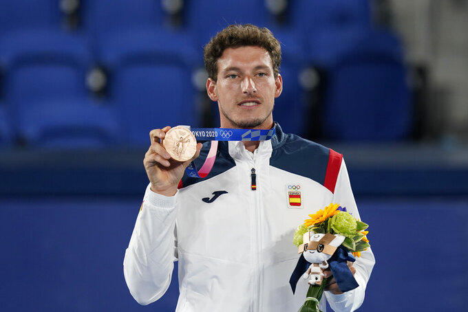 Pablo Carreno Busta, of Spain, poses with the bronze medal in the men's single of the tennis competition at the 2020 Summer Olympics, Sunday, Aug. 1, 2021, in Tokyo, Japan. (AP Photo/Patrick Semansky)