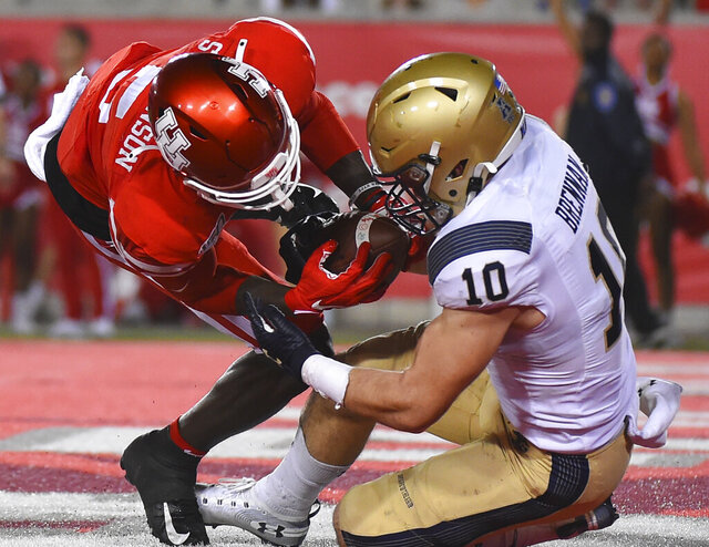 Navy safety Kevin Brennan (10) intercepts a pass in the end zone intended for Houston wide receiver Marquez Stevenson during the second half of an NCAA college football game, Saturday, Nov. 30, 2019, in Houston. (AP Photo/Eric Christian Smith)