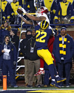 Indiana wide receiver Ty Fryfogle (3) catches a touchdown pass as Michigan defensive back David Long (22) defends in the first half of an NCAA college football game in Ann Arbor, Mich., Saturday, Nov. 17, 2018. (AP Photo/Paul Sancya)