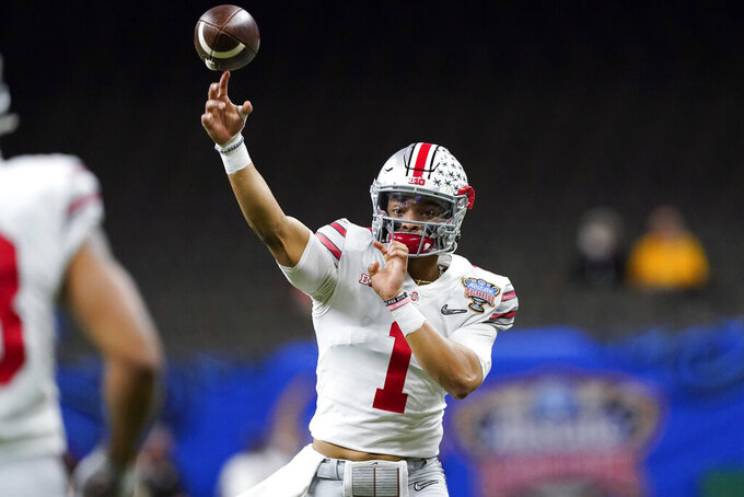 Ohio State quarterback Justin Fields passes against Clemson during the first half of the Sugar Bowl NCAA college football game Friday, Jan. 1, 2021, in New Orleans. (AP Photo/John Bazemore)