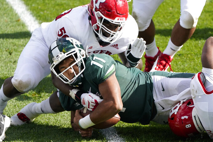 Rutgers defensive lineman Julius Turner (50) tackles Michigan State running back Connor Heyward (11) during the second half of an NCAA college football game, Saturday, Oct. 24, 2020, in East Lansing, Mich. (AP Photo/Carlos Osorio)