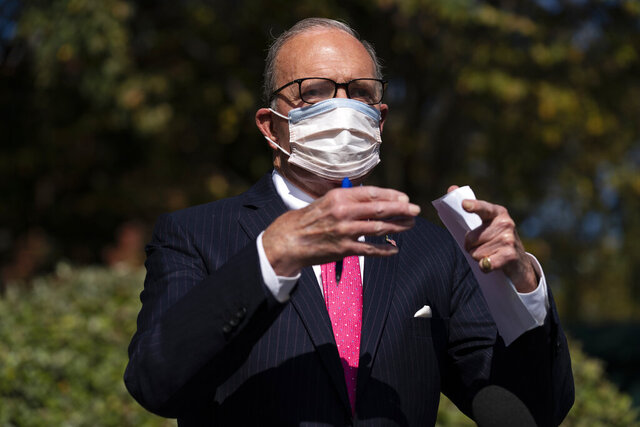 White House chief economic adviser Larry Kudlow talks with reporters outside the White House about coronavirus relief package negotiations, Friday, Oct. 9, 2020, in Washington. (AP Photo/Evan Vucci)