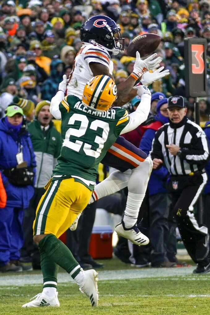 Chicago Bears' Allen Robinson II catches a pass in font of Green Bay Packers' Jaire Alexander during the second half of an NFL football game Sunday, Dec. 15, 2019, in Green Bay, Wis. (AP Photo/Morry Gash)