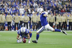 Indianapolis Colts kicker Adam Vinatieri (4) boots a 34-yard field goal out of the hold of Rigoberto Sanchez (8) during the first half of an NFL football game against the Jacksonville Jaguars, Sunday, Nov. 17, 2019, in Indianapolis. (AP Photo/Michael Conroy)