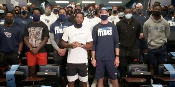 In a screenshot from a Zoom call, Tennessee Titans players speak about the decision to cancel NFL football practice Thursday, Aug. 27, 2020, in Nashville, Tenn. Several NFL teams canceled practice in response to the shooting of Jacob Blake, a Black man, in Wisconsin. In front are safety Kevin Byard, left, and quarterback Ryan Tannehill, right. (AP Photo)
