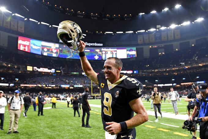 New Orleans Saints quarterback Drew Brees (9) runs off the field after an NFL football game against the Houston Texans in New Orleans, Monday, Sept. 9, 2019. The Saints won 30-28. (AP Photo/Bill Feig)