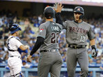 Arizona Diamondbacks' Nick Ahmed (13) celebrates his two-run home run with Jake Lamb (22) during the second inning of the team's baseball game against the Los Angeles Dodgers on Tuesday, July 2, 2019, in Los Angeles. (AP Photo/Marcio Jose Sanchez)