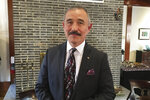 In this Thursday, Jan. 16, 2020, photo, U.S. Ambassador to South Korea Harry Harris poses after a briefing with a group of foreign reporters at his residence in Seoul, South Korea. Harris has some unusual explanations for the harsh criticism he's faced in his host country. His mustache, maybe? Or a Japanese ancestry that raises unpleasant reminders of Japan's former colonial domination of Korea? (AP Photo/Hyung-Jin Kim)