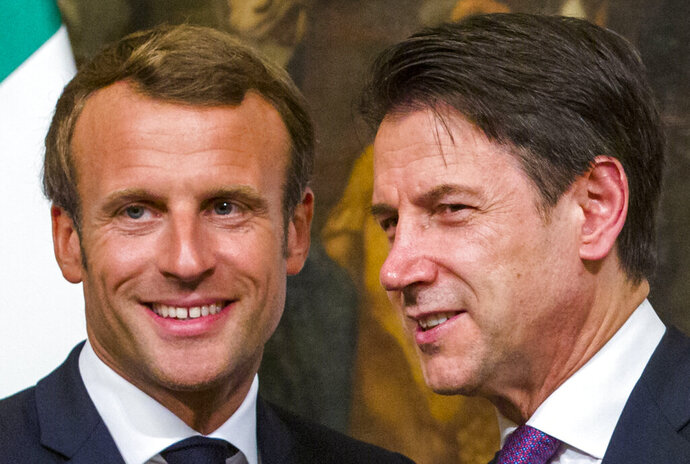 French President Emmanuel Macron, left, and Italian Premier Giuseppe Conte pose as they meet the media at Chigi Palace Premier office in Rome, Wednesday, Sept. 18, 2019. How Europe can better deal with migrant policies is slated to be a key matter for talks as Macron and Conte met in Rome Wednesday evening. (AP Photo/Domenico Stinellis)