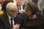 Labour Party leader Jeremy Corbyn, left and Sinn Fein leader Mary Lou McDonald talk, prior to the start of the funeral service of slain journalist Lyra McKee at St Anne's Cathedral in Belfast, Northern Ireland, Wednesday April 24, 2019.  The leaders of Britain and Ireland will join hundreds of mourners Wednesday at the funeral of Lyra McKee, the young journalist shot dead during rioting in Northern Ireland last week. (Brian Lawless/Pool Photo via AP