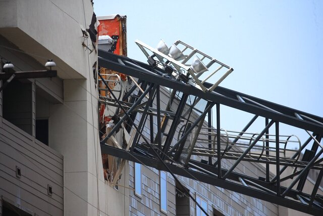 FILE- In this June 9, 2019, file photo, officials respond to the scene after a crane collapsed into Elan City Lights apartments amid severe thunderstorms in Dallas. The Occupational Safety and Health Administration in December 2019 imposed a nearly $26,000 fine against Bigge Crane and Rigging Co. for failing to inspect properly the collapsed crane. (Shaban Athuman/The Dallas Morning News via AP, File)