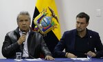 Ecuadorian President Lenin Moreno, left, speaks during negotiations with anti-government protesters as Arnaud Peral Resident Coordinator of the United Nations System and UNDP Representative in Ecuador, right, listen in Quito, Ecuador, Sunday, Oct. 13, 2019. The government and indigenous protesters started negotiations aimed at defusing more than a week of demonstrations that have paralyzed the nation's economy. (AP Photo/Fernando Vergara)