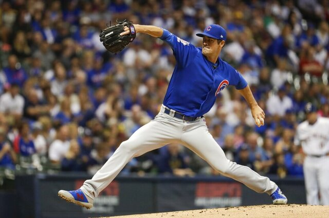 FILE - In this Sept. 6, 2019, file photo, Chicago Cubs starting pitcher Cole Hamels throws during the first inning of a baseball game against the Milwaukee Brewers, in Milwaukee.  Left-hander Cole Hamels agreed to an $18 million, one-year contract with the Atlanta Braves, one of the more active teams of the offseason. (AP Photo/Morry Gash, File)