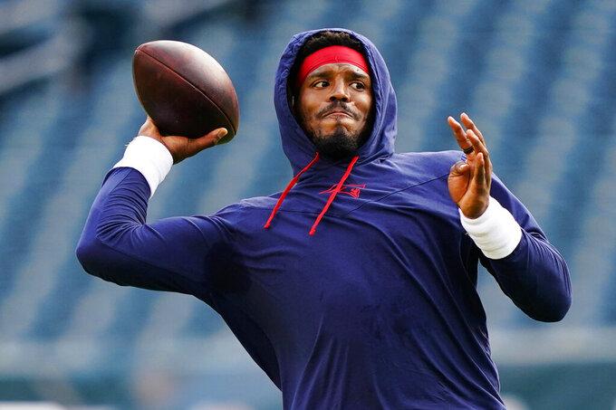 New England Patriots' Cam Newton warms up before a preseason NFL football game Philadelphia Eagles on Thursday, Aug. 19, 2021, in Philadelphia. (AP Photo/Matt Rourke)