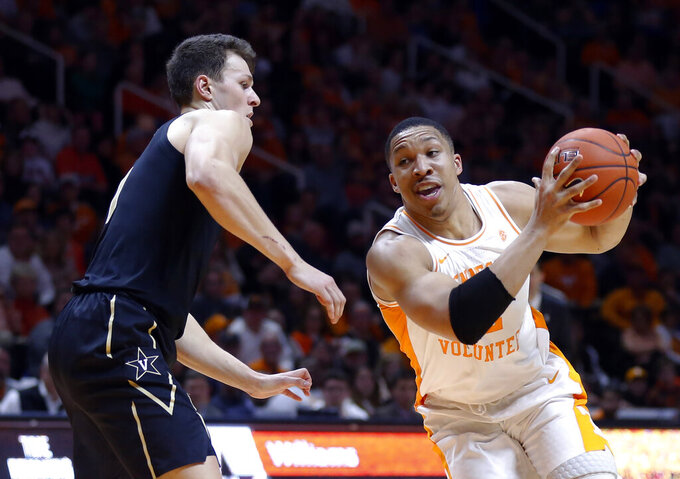 Tennessee forward Grant Williams (2) drives past Vanderbilt forward Yanni Wetzell during the second half of an NCAA college basketball game Tuesday, Feb. 19, 2019, in Knoxville, Tenn. Tennessee won 58-46. (AP photo/Wade Payne)
