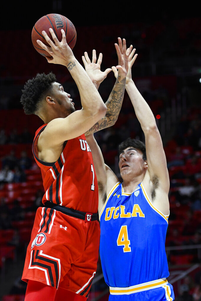 Utah forward Timmy Allen (1) shoots over UCLA guard Jaime Jaquez Jr. during the second half of an NCAA college basketball game Thursday, Feb. 20, 2020, in Salt Lake City. (AP Photo/Alex Goodlett)