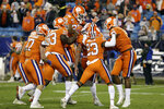 Clemson players cxelebrate late in the second half of the Atlantic Coast Conference championship NCAA college football game against Virginia in Charlotte, N.C., Saturday, Dec. 7, 2019. Clemson won 62-17. (AP Photo/Gerry Broome)