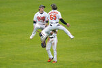 Baltimore Orioles left fielder Austin Hays, left, right fielder Ryan McKenna, right, and center fielder Cedric Mullins celebrate after defeating the New York Yankees 10-6 during a baseball game, Sunday, May 16, 2021, in Baltimore. (AP Photo/Julio Cortez)