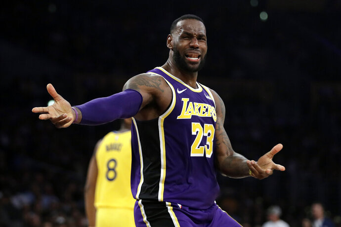 Los Angeles Lakers' LeBron James questions a call during the second half of the team's NBA basketball game against the Golden State Warriors on Wednesday, Nov. 13, 2019, in Los Angeles. (AP Photo/Marcio Jose Sanchez)
