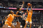 Tennessee's Rae Burrell (12) shoots over Connecticut's Megan Walker (3) and Connecticut's Anna Makurat (24) as Tennessee's Kasiyahna Kushkituah (11) defends in the first half of an NCAA college basketball game, Thursday, Jan. 23, 2020, in Hartford, Conn. (AP Photo/Jessica Hill)