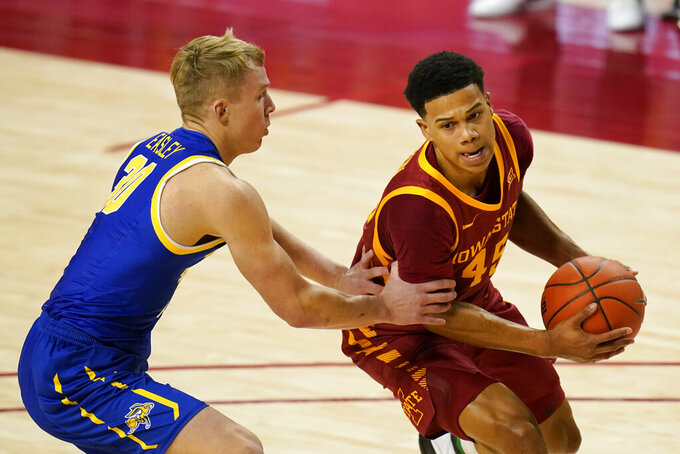 Iowa State guard Rasir Bolton drives to the basket past South Dakota State guard Charlie Easley, left, during the second half of an NCAA college basketball game, Wednesday, Dec. 2, 2020, in Ames, Iowa. (AP Photo/Charlie Neibergall)