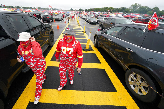 Fans arrive at Arrowhead Stadium before an NFL football game between the Kansas City Chiefs and the Houston Texans Thursday, Sept. 10, 2020, in Kansas City, Mo. (AP Photo/Charlie Riedel)