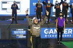 Sheldon Creed celebrates in Victory Lane after winning the NASCAR Truck Series auto race at Phoenix Raceway, Friday, Nov. 6, 2020, in Avondale, Ariz. With the victory, Creed won the series championship. (AP Photo/Ralph Freso)