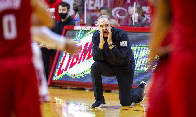 Rutgers head coach Steve Pikiell communicates with the players on the court during the second half of an NCAA college basketball game against Indiana, Sunday, Jan. 24, 2021, in Bloomington, Ind.  (AP Photo/Doug McSchooler)