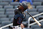 Miami Marlins' Jazz Chisholm Jr. hits a run scoring ground rule double against the New York Mets during the fifth inning of the first game of a baseball doubleheader that started April 11 and was suspended because of rain, Tuesday, Aug. 31, 2021, in New York. (AP Photo/Adam Hunger)