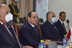Egypt's President Abdel-Fattah el-Sissi, center, meets with South Sudan's President Salva Kiir at the president's office in the capital Juba, South Sudan Saturday, Nov. 28, 2020. The Egyptian president is on a one-day visit to discuss bilateral relations. (AP Photo/Maura Ajak)