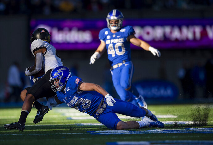 Air Force's Dane Kinamon (23) goes in for a tackle against Army's Akyah Miranda (4) during the fourth quarter of an NCAA college football game in Air Force Academy, Colo., Saturday, Nov. 2, 2019. (Chancey Bush/The Gazette via AP)