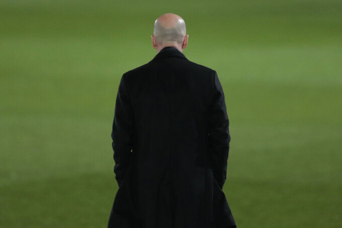 FILE - In this file photo dated March 1, 2021, Real Madrid's head coach Zinedine Zidane waits for the start of the Spanish La Liga soccer match between Real Madrid and Real Sociedad at Alfredo di Stefano stadium in Madrid, Spain. Zinedine Zidane is again stepping down as Real Madrid coach. The club says the Frenchman is leaving his job. It comes four days after a season in which Madrid failed to win a title for the first time in more than a decade. (AP Photo/Bernat Armangue, File)