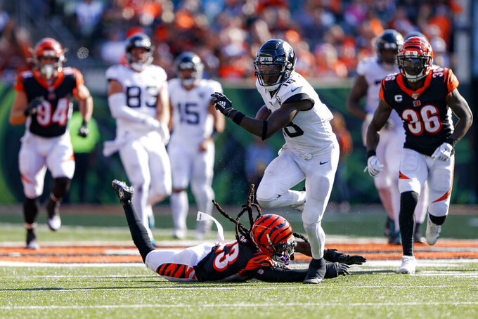 Jacksonville Jaguars wide receiver Chris Conley (18) breaks away from Cincinnati Bengals cornerback B.W. Webb, bottom, in the second half of an NFL football game, Sunday, Oct. 20, 2019, in Cincinnati. (AP Photo/Gary Landers)