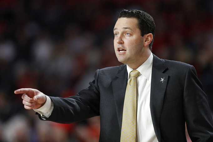 Vanderbilt coach Bryce Drew gives directions from the bench during an NCAA college basketball game against Georgia, Wednesday, Jan. 9, 2019 in Athens, Ga. (Joshua L. Jones/Athens Banner-Herald via AP)