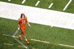 Clemson quarterback Trevor Lawrence leaves the field after their loss against Ohio State during the Sugar Bowl NCAA college football game Friday, Jan. 1, 2021, in New Orleans. Ohio State won 49-28. (AP Photo/Butch Dill)