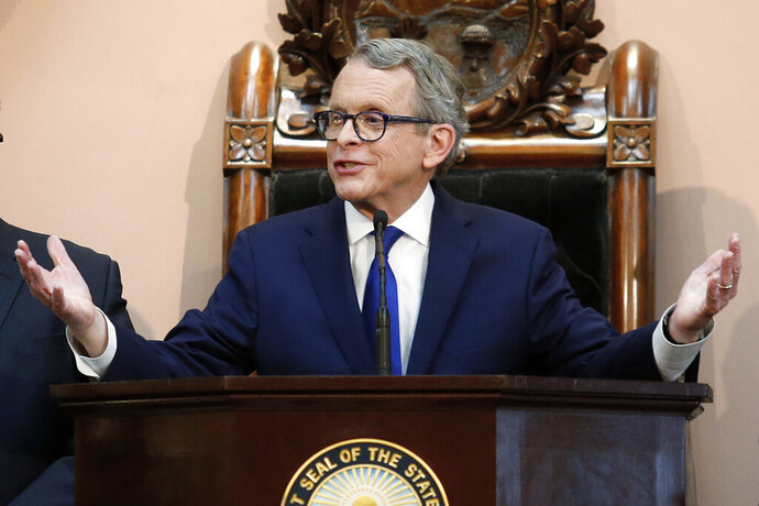 FILE - In this March 5, 2019, file photo, Ohio Gov. Mike DeWine speaks during the Ohio State of the State address at the Ohio Statehouse in Columbus, Ohio. Every Tuesday for months, DeWine interrupts his remarks on pandemic stats and safety measures and pleads with fellow Republican lawmakers to act on his legislation addressing gun violence in the state. DeWine proposed the bill after a mass shooting in Dayton in 2019. A key element is boosting penalties for felons committing new crimes with guns. The governor says the need has only grown more dire since Dayton. (AP Photo/Paul Vernon, File)