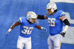 Los Angeles Chargers running back Austin Ekeler (30) celebrates his touchdown with center Dan Feeney (66) during the first half of an NFL football game against the Denver Broncos Sunday, Dec. 27, 2020, in Inglewood, Calif. (AP Photo/Kelvin Kuo)