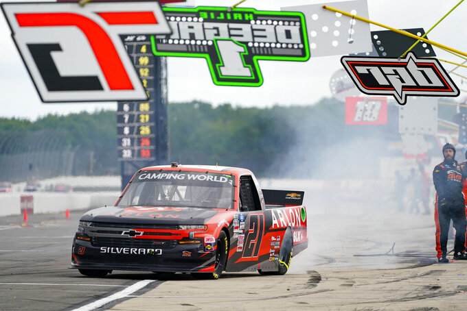 Zane Smith (21) leaves a pit stop during a NASCAR Truck Series auto race at Pocono Raceway, Saturday, June 26, 2021, in Long Pond, Pa. (AP Photo/Matt Slocum)