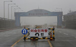 A barricade is placed near Unification Bridge, which leads to the demilitarized zone, near the border village of Panmunjom in Paju, South Korea, Wednesday, May 16, 2018. North Korea on Wednesday canceled a high-level meeting with South Korea and threatened to scrap a historic summit next month between U.S. President Donald Trump and North Korean leader Kim Jong Un over military exercises between Seoul and Washington that Pyongyang has long claimed are invasion rehearsals. The barricade reads: