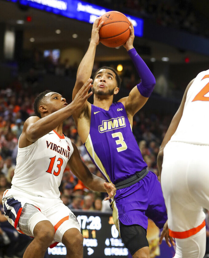 James Madison guard Deshon Parker (3) shoots next to Virginia guard Casey Morsell (13) during an NCAA college basketball game in Charlottesville, Va., Sunday, Nov. 10, 2019. (AP Photo/Andrew Shurtleff)