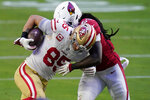 San Francisco 49ers tight end George Kittle (85) is hit by Arizona Cardinals center Lamont Gaillard (53) during the second half of an NFL football game, Saturday, Dec. 26, 2020, in Glendale, Ariz. (AP Photo/Ross D. Franklin)