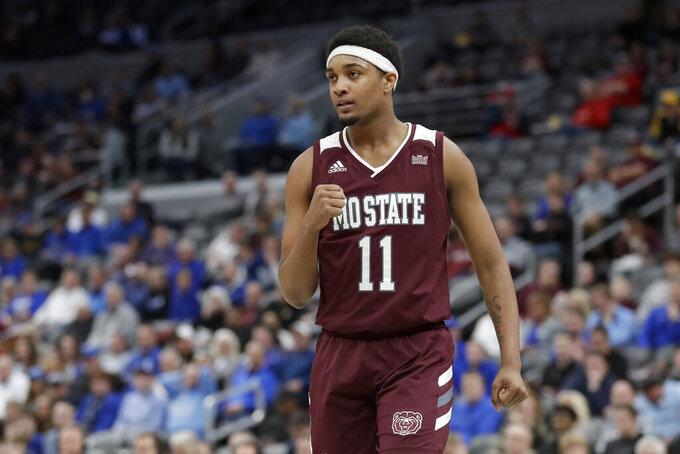 Missouri State's Isiaih Mosley celebrates during the first half of an NCAA college basketball game against Indiana State in the quarterfinal round of the Missouri Valley Conference men's tournament Friday, March 6, 2020, in St. Louis. (AP Photo/Jeff Roberson)