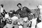 FILE - In this Dec. 3, 1977, file photo, Florida State head coach Bobby Bowden is carried on the shoulders of defensive end Willie Jones (88) and nose guard Ron Simmons (50) after the team defeated Florida 37-9 in a college football game in Gainesville, Fla. Bowden, the folksy Hall of Fame coach who built Florida State into an unprecedented college football dynasty, has died. He was 91. Bobby's son, Terry, confirmed to The Associated Press that his father died at home in Tallahassee, Fla., surrounded by family early Sunday, Aug. 8, 2021. (AP Photo/File)