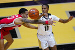 Purdue guard Isaiah Thompson (11) makes a pass over Ohio State guard CJ Walker (13) during the second half of an NCAA college basketball game in West Lafayette, Ind., Wednesday, Dec. 16, 2020. (AP Photo/Michael Conroy)