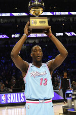 Miami Heat's Bam Adebayo holds the trophy after winning NBA basketball's All-Star skills challenge Saturday, Feb. 15, 2020, in Chicago. (AP Photo/David Banks)