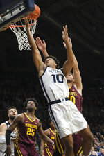 Butler forward Bryce Nze (10) shoots in front of Minnesota forward Alihan Demir (30) in the first half of an NCAA college basketball game in Indianapolis, Tuesday, Nov. 12, 2019. (AP Photo/AJ Mast)