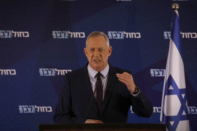 Blue and White party leader Benny Gantz delivers a statement in Tel Aviv, Israel, Saturday, March 7, 2020. (AP Photo/Sebastian Scheiner)