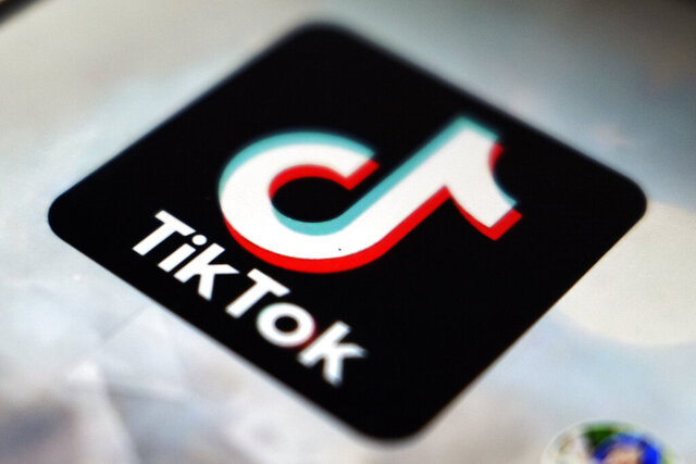 FILE - In this Sept. 28, 2020 file photo, a view of the TikTok app logo, in Tokyo. Popular short-video Chinese app TikTok is cutting its workforce in India after with hundreds of millions of its users dropped it to comply with a government ban on dozens of Chinese apps amid a military standoff between the two countries.(AP Photo/Kiichiro Sato, File)